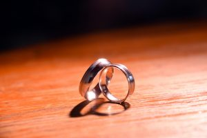 Civil Partnerships - Wedding rings on a wood