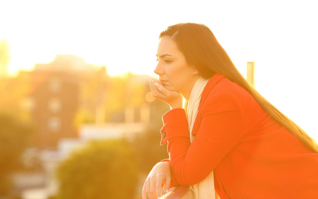 Pensive woman thinking about who gets the house in a divorce