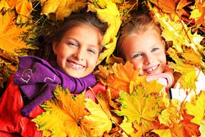Picture of children in leaves