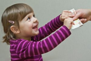 picture of a child receiving money